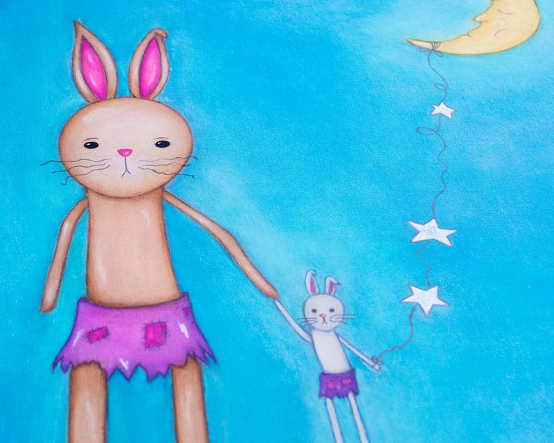 painting of a stuffed bunny and a moon on a blue background