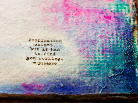 Picasso quote stamped on mixed media background