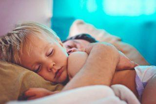 toddler boy asleep in bed