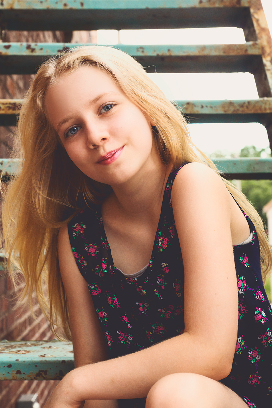 Blonde girl sitting on stairs