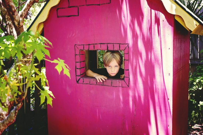 child in a play house