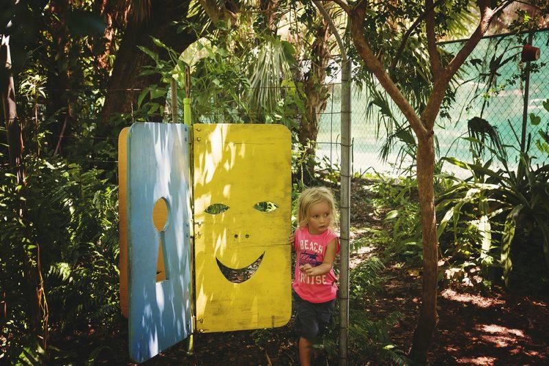 toddler in a garden maze
