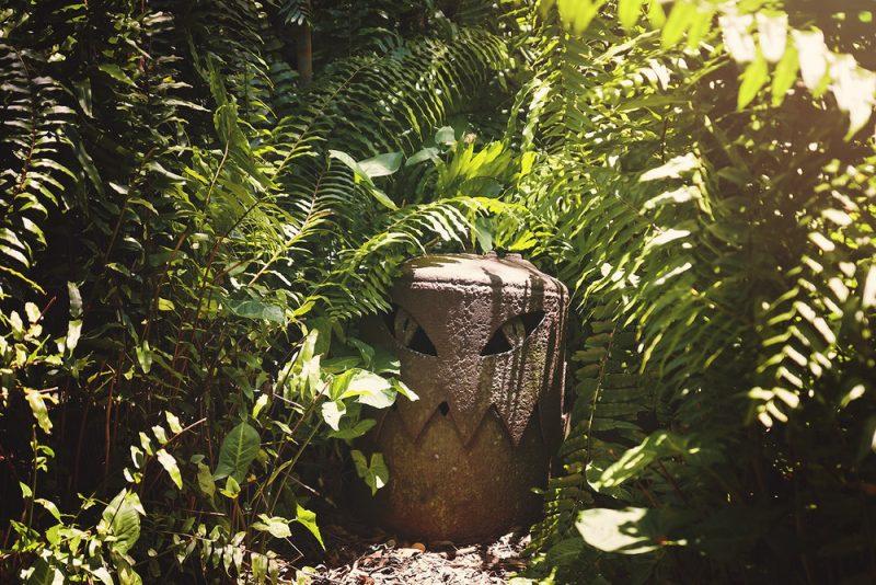 metal monster sculpture in a garden
