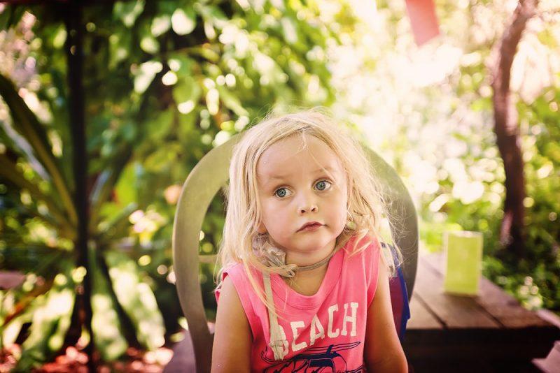 toddler in a chair in a garden