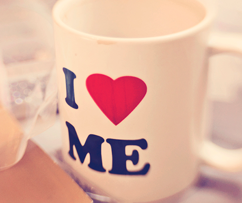 "White coffee mug with the text ""I"