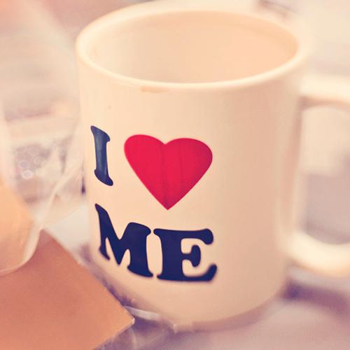 "White coffee mug with the text ""I"